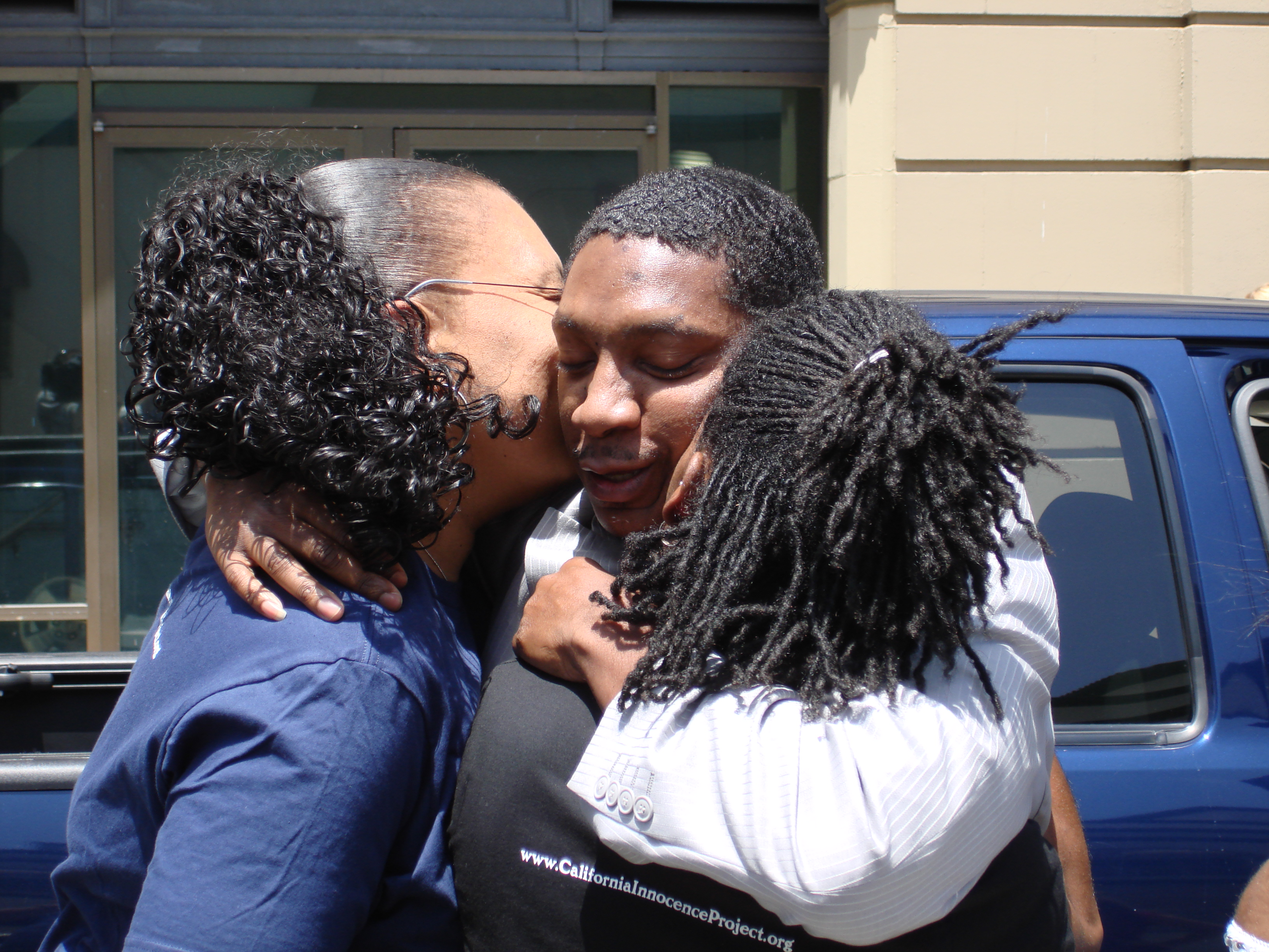 Innocence Project of CA client Reggie Cole hugging relatives