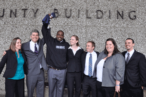 Brian Banks stands with California Innocence Project staff