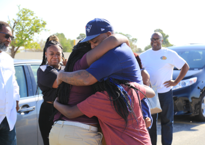 Rodney Gupton Hugs Family